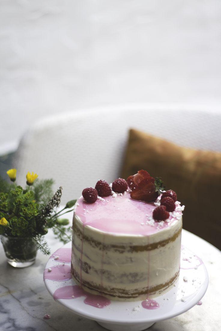 Semi-naked lemon cake, raspberry jam and coconut buttercream