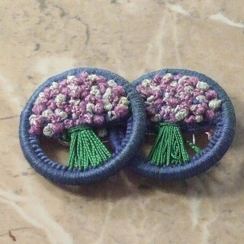 Rare double Dorset thread vintage buttons flower bunches Blue surround with pink and white flowers sewn into a bunch with green stalks The vintage buttons have been turned into a pin brooch