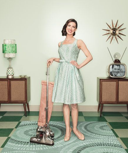 Woman cleaning in a dress and heels | How to clean more efficiently.