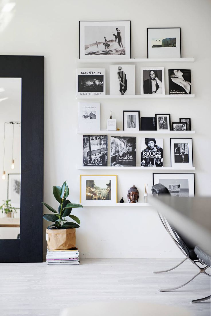 Perfect photo ledge wall: framed photos mixed with books and magazines. Are you looking for unique and beautiful art photo prints (not the ones featured in this pin) to create your gallery walls? Visit bx3foto.etsy.com and follow us on IG @bx3foto