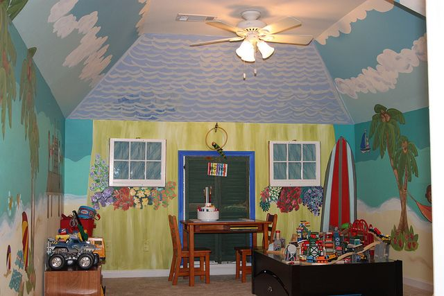 Transforming a Blah Playroom into Paradise with a Beach Mural.  Would not be hard, at all.