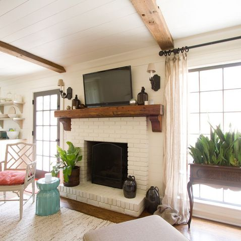 White Brick Fireplace - Love the added mirrored lights, natural wood hearth top with natural, raw white color brick combine with ferns or greenery?---gorgeous!