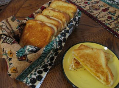 Baked grilled cheese  Preheat oven to 450 Lightly butter each slice of bread. Place on a cookie sheet butter side down. Place two slices cheese on each piece of bread. Place other slice of bread on top. Bake for approximately 5 min, then flip sandwich over Bake an additional 3-4 min.