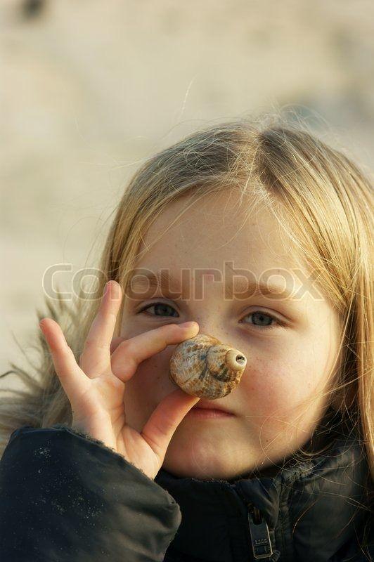 Autumn girl uses snail shell as nose | Stock Photo | Colourbox on Colourbox
