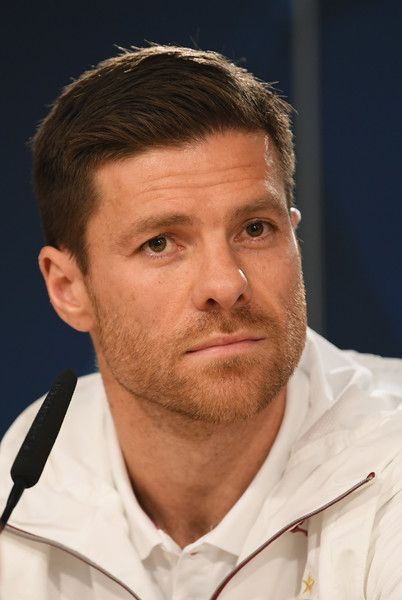 Xabi Alonso Photos Photos - Xabi Alonso of Bayern Muenchen looks on during a press conference at Estadio Santiago Bernabeu on April 17, 2017 in Madrid, Spain. - FC Bayern Muenchen - Training & Press Conference