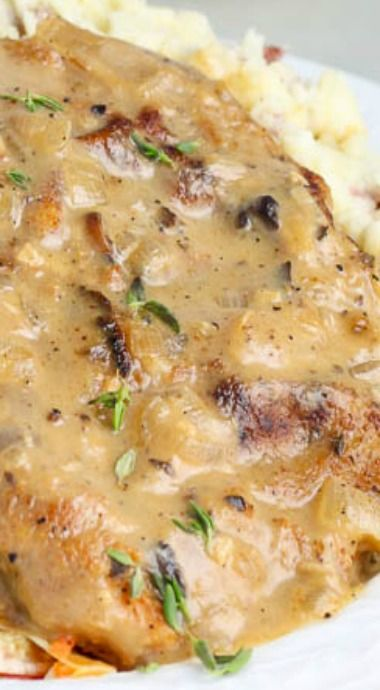 Baked Mushroom Pork Chops ~ seasoned, breaded, and seared before being baked to perfection under a succulent wine and mushroom thyme sauce.