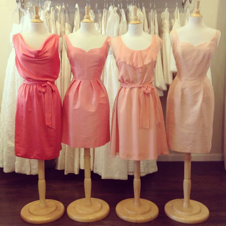 A progression from a Deep Coral to a Soft Peach makes for a perfect wedding color palette.  Dresses by Anna Elyse.