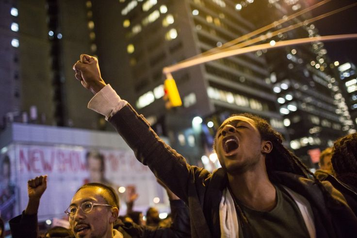 People take part in a protest against the grand jury decision on the death of Eric Garner in midtown Manhattan in New York