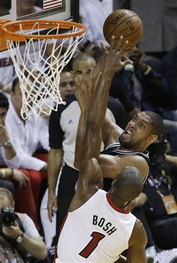 The San Antonio Spurs' Tim Duncan (21) shoots over Miami Heat's Chris Bosh (1) during the second half in Game 7 of the NBA basketball championships, Thursday, June 20, 2013, in Miami