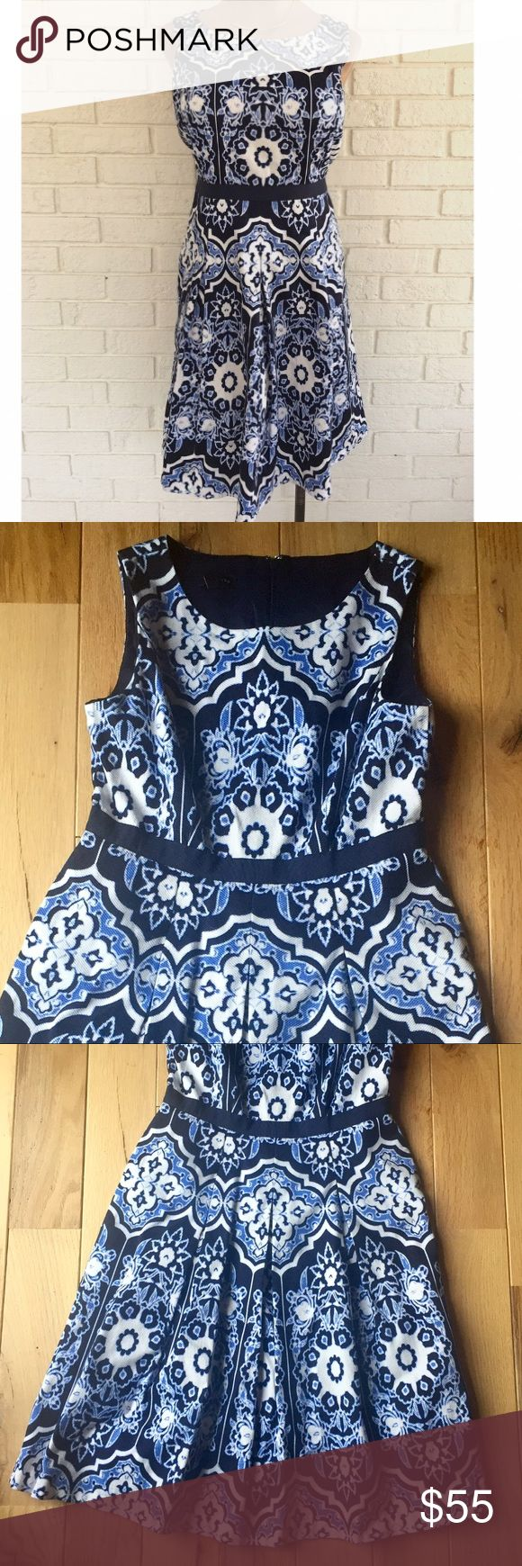 {Talbots}NWOT Blue & White Dress New With Out Tags. Retails at $169. Navy, blue, and white printed fit and flare sleeveless dress. High round neckline. Navy waist line. Skirt fits loose and is pleated. Zips down the back. Size 2P from Talbots petites. 💲Will take best reasonable offer. Talbots Dresses