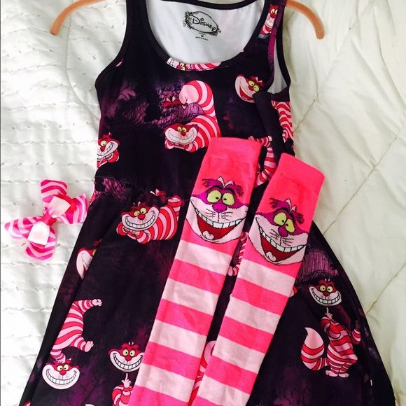 Cheshire Cat outfit! Super cute...worn once! Very cute Cheshire Cat outfit worn once for an Alice in Wonderland themed bridal shower. Dress, Thigh highs, bow included. Dress is a size medium. Thigh highs are one size fits most. Disney Other