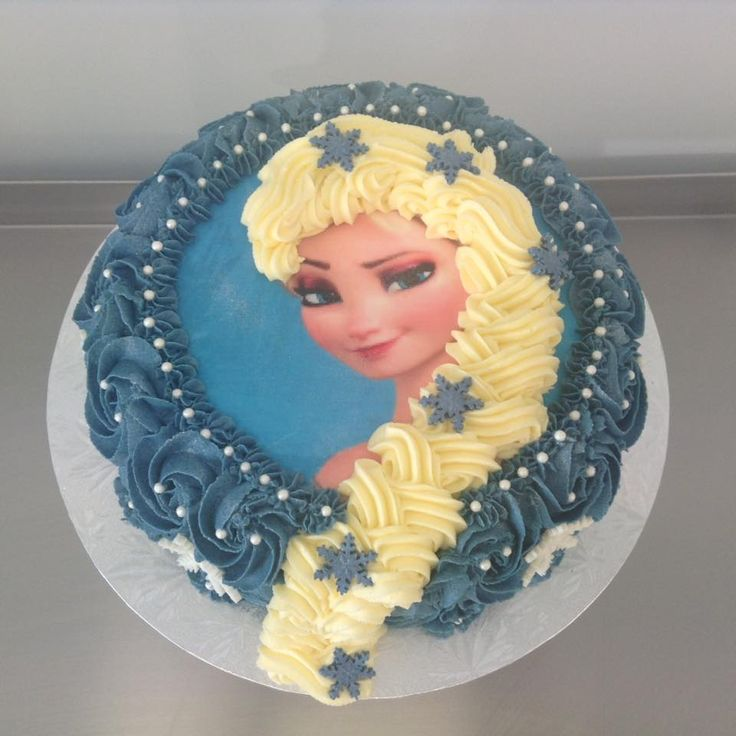 Frozen Elsa Themed Cake with Edible Image and Blue Rosette Frosting decorated by Coast Cakes Ltd
