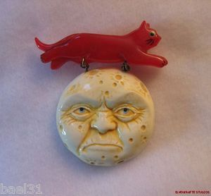 My first bakelite Halloween Pin for 2013 on ebay, a Cat jumping over a Full Moon.