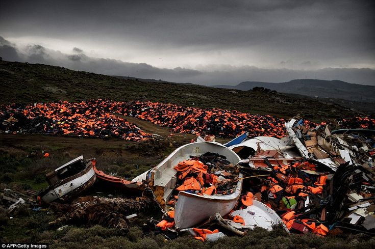 Wrecked boats and thousands of life jackets used by refugees and migrants during their journey across the Aegean sea lie in a dump in Mithimna on February 19