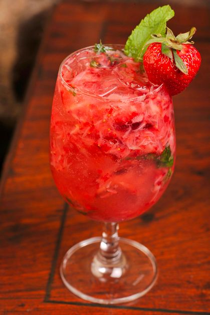 Strawberry Mojito.Bucky's Strawberry Mojito 1.5 oz light rum 1 oz simple syrup   2 lime wedges  5 to 6 mint leaves  1 medium-to-large ripened strawberry (hulled).  In mixing glass, muddle strawberry, mint,lime and simple syrup.  Add rum. Add 1 scoop of ice and shake.   3. Pour entire contents of shaker into glass and top with club soda.   4. Garnish with fresh strawberry and a mint sprig.