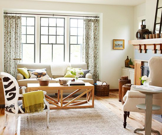 Create coziness, depth, and detail by varying types of textures -- smooth, coarse, and fibrous -- in small rooms. In this living room, a mostly neutral scheme gains interest by marrying luxe fabrics with honey-hue tones. Unexpected hits of color such as a pillow or a throw enliven the space and can be changed out cheaply.
