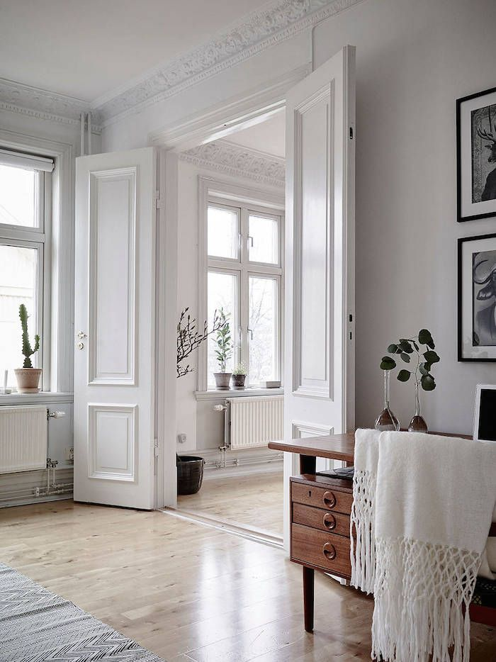 swedish apartment | love the light wood floors paired with white walls.. lets you add pops of color with furniture/decor