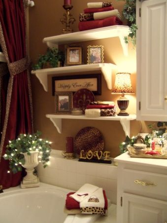 I love the alternating shelves with the small lamp.  Over the tub!