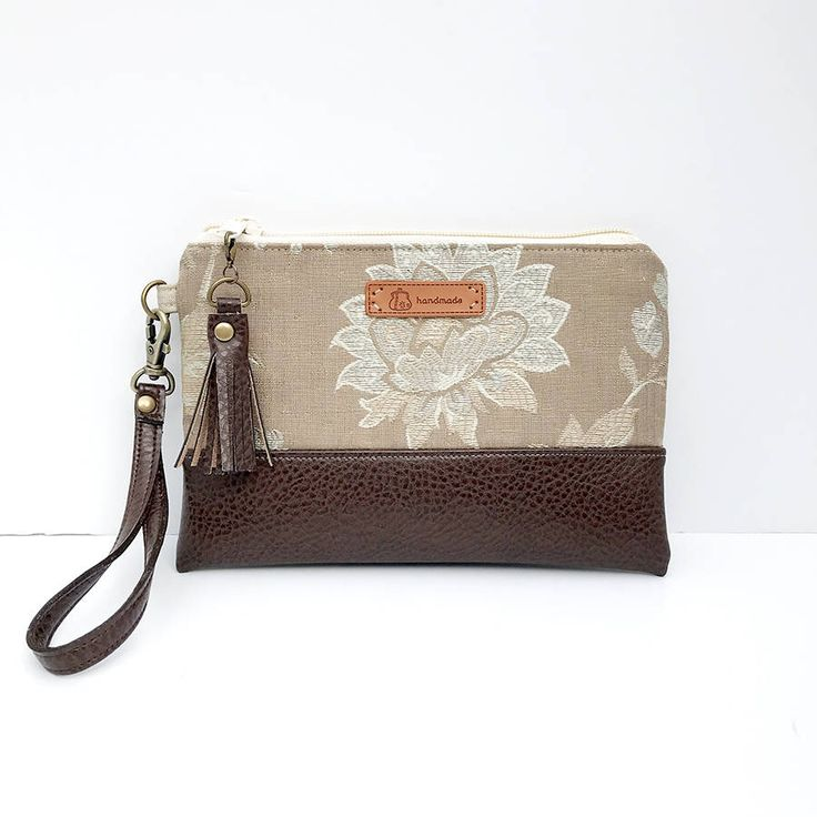 A personal favorite from my Etsy shop https://www.etsy.com/listing/595577565/truffle-floral-wristlet-fits-iphone-10-x