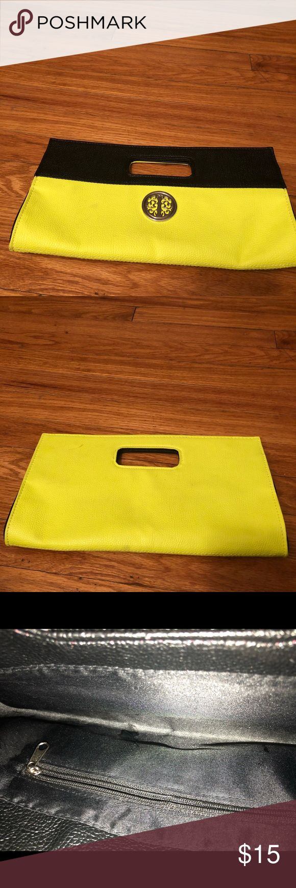 Neon yellow and black clutch Neon yellow and black clutch. Has a small blemish on the back in the top left hand corner. Bags Clutches & Wristlets
