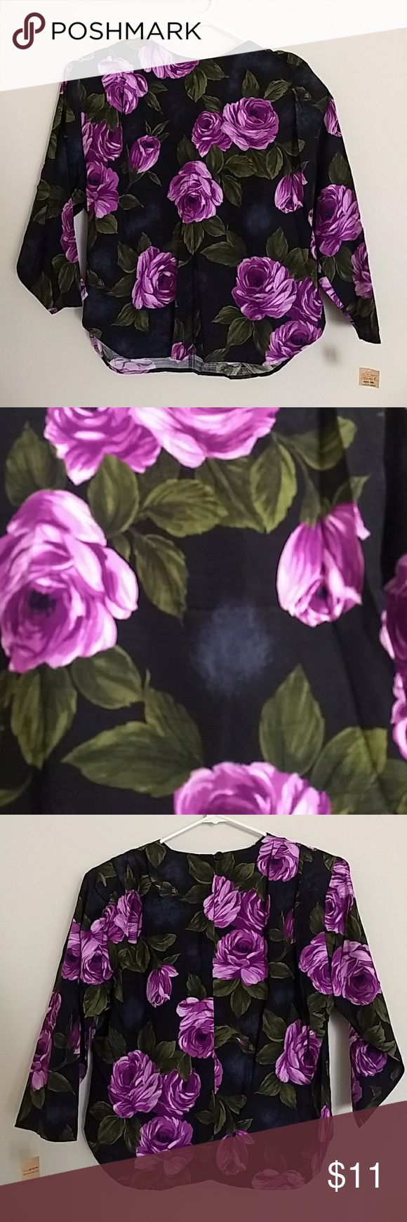 "Vintage Floral Roses Blouse 100% Rayon. NWT by Melrose. This blouse is reminiscent of BJ Punk Label. It features shoulder pads (easily removable if you don't prefer them!) and quarter sleeves. Measurements: 17.75"" sleeve. 20"" seat. 22.25"" length. 22"" bust. I've had this item in storage for quite some time, so it needs laundering! One small hole at shoulder, pictured. Price reflects this. Vintage Tops Blouses"