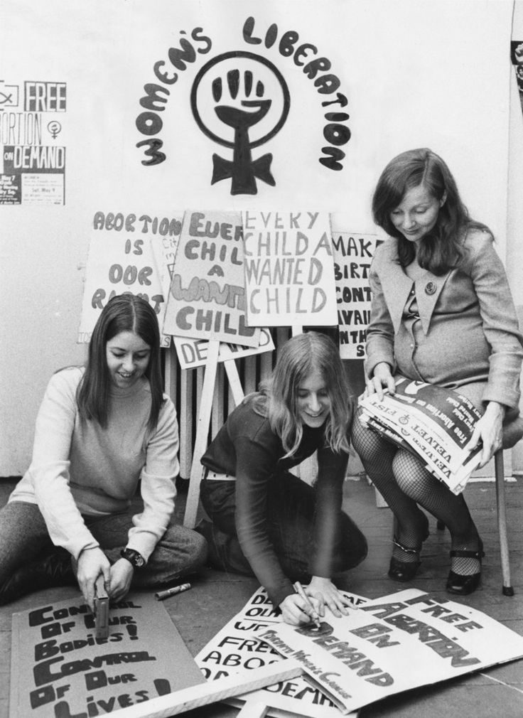 Feminists working on placards and signs making ready for a Women's Liberation Movement march or demonstration.  Circa 1970.