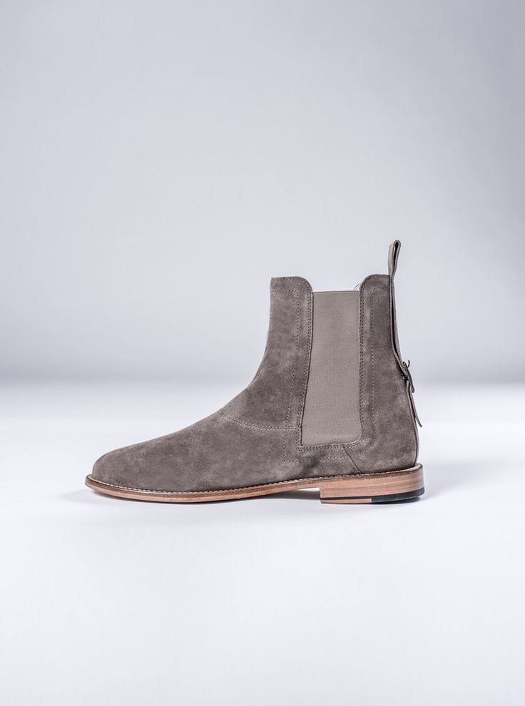 Signature Chelsea Boot   Available for pre-order  $260.00    The boot has a tall height and flat toe shape. Finished with the softest durable suede in the world by one of the best boot makers in the world. Suede pull-tabs and embossed logo at the rear of the shoe & insole. With a unique buckle at the back of the rear spine to add that special touch.  Each shoe will come with a beautiful matte box, and travel shoe covers.    Imported Fabrics from Italy  Handcrafted & Made in Portugal