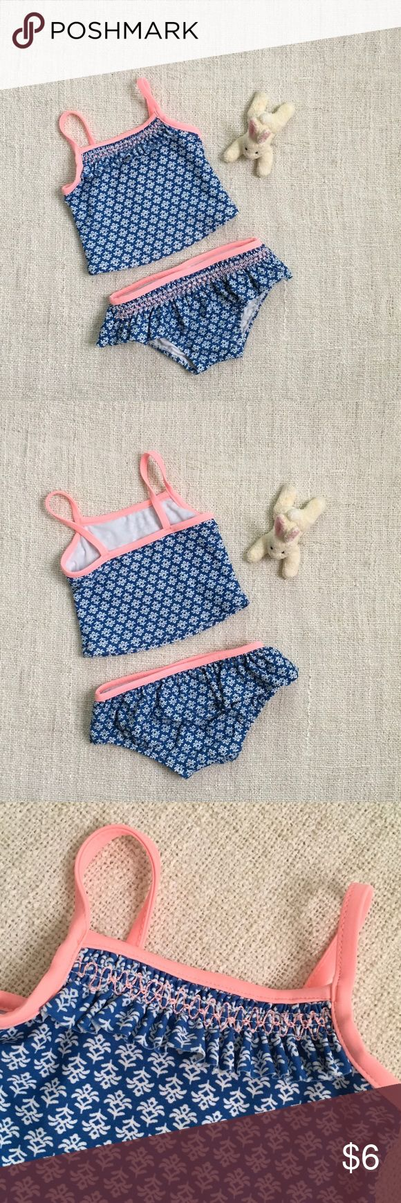 EUC: Girls 12 Mos Tankini 🏄♀️🏄♀️🏄♀️ Adorable blue and white print two piece with pink/peach trim and ruffle accents. No pulls or snags. Carter's Swim One Piece