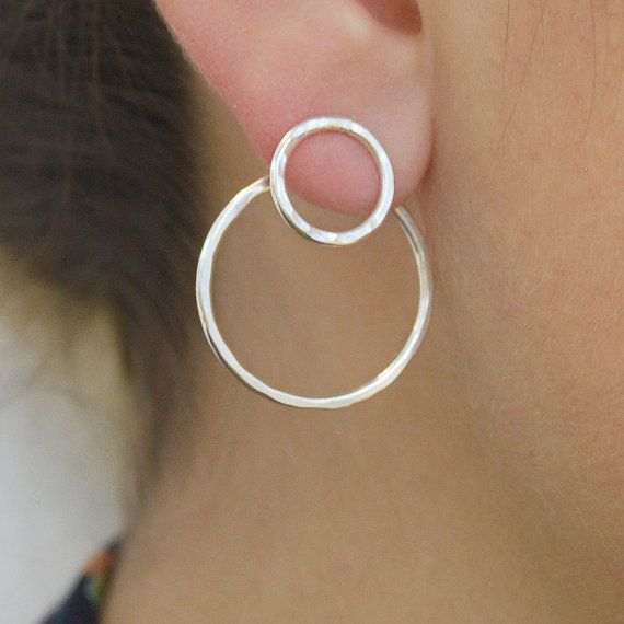 These sterling silver circular cut-out ear jackets are slightly hammered for a more distinct and daring look, quirky, individual and unique! Wear just the stud for a wearable daytime look, or add the jacket for an eye-catching addition for the evening. Simply insert the stud into the ear,