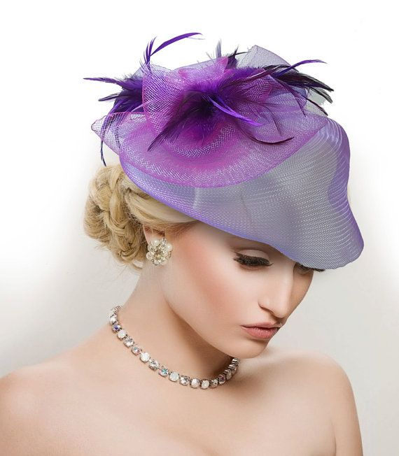 This is a beautiful handmade Purple Fascinator with modern purple, beautiful handmade flower, wired feather as the finishing with alligator clip. This