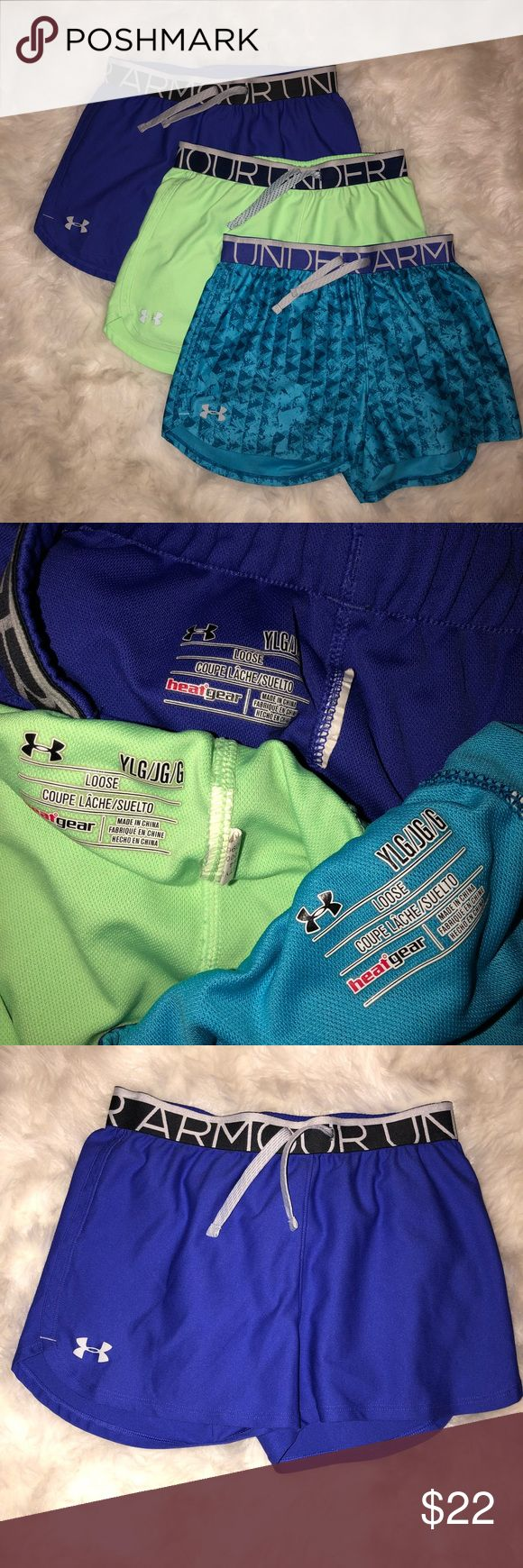 Under Armor Set of Shorts Youth L This set comes with dark purple shorts lime green shorts and light and dark blue shorts. The purple and blue shorts are in perfect condition. The green ones has small spots on the front and back. But overall in good condition! Under Armour Bottoms Shorts