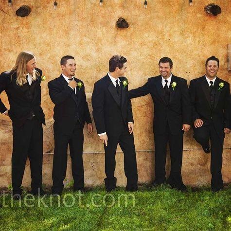 A simple black suit, vest & tie -- classic groomsmen look!