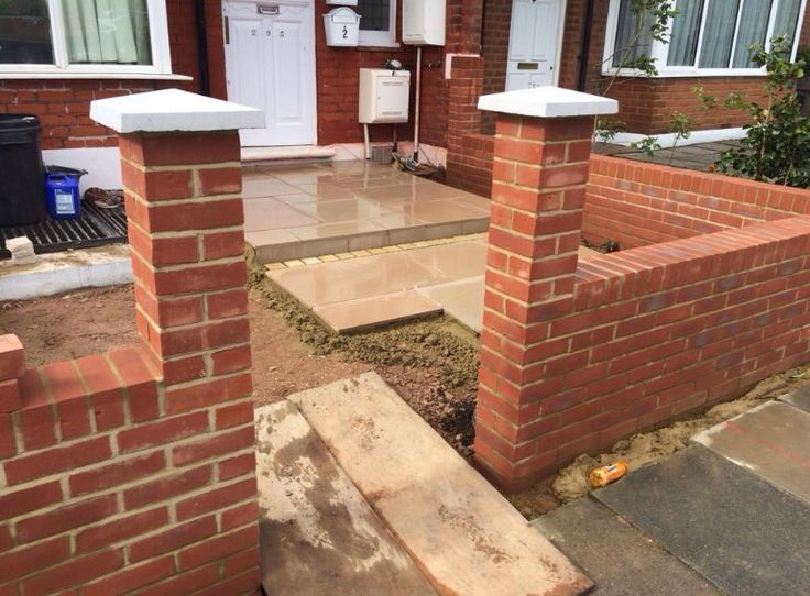 front garden wall in 9 stretcher bond with piers and boe wrought iron railings - Brick Garden 2015