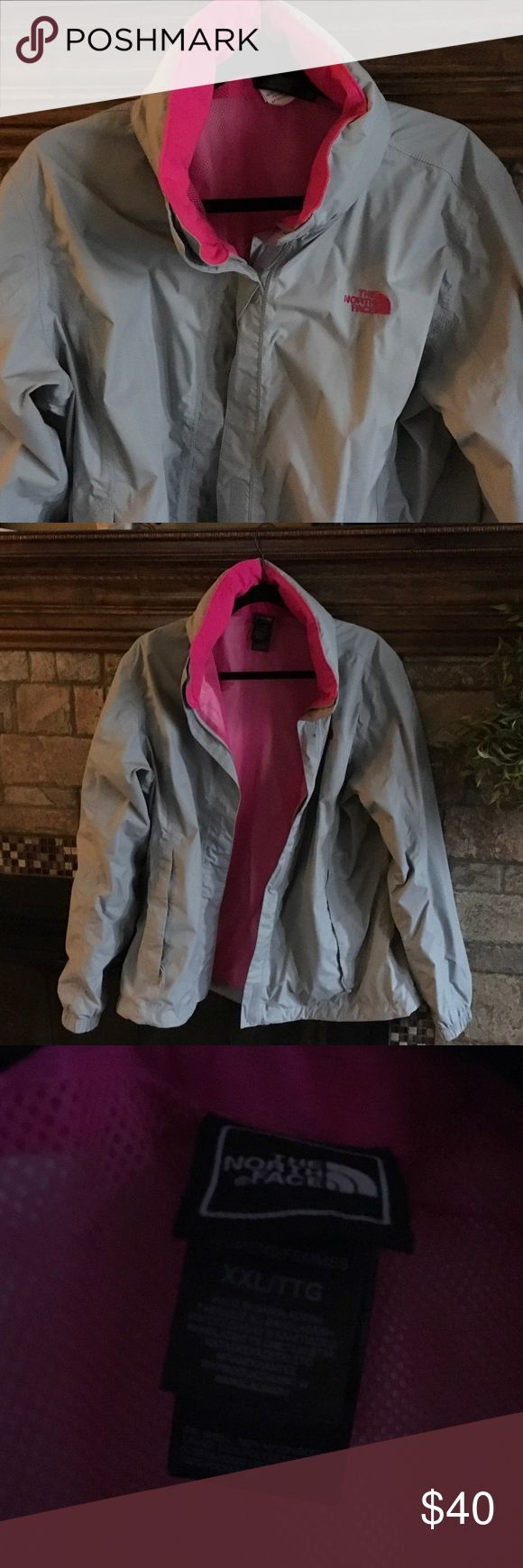North face rain and wind breaker grey/pink XXL The north face wind and rain jacket ladies XXL in grey and pink. Hood is stashed away in the collar. Zips and Velcro closure. Worn on one vacation. The North Face Jackets & Coats