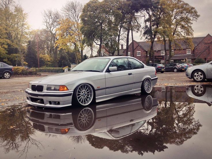 Silver BMW e36 coupe slammed on OEM BMW Styling 32 wheels ...