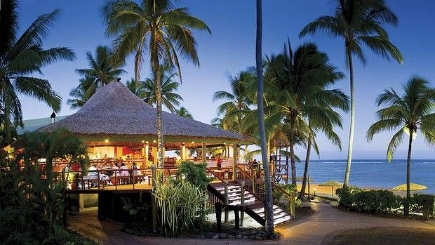 Travel Destination Fiji - Island paradise ... guests soak up the sunset ambience at Sundowner Bar & Grill, Outrigger on the Lagoon.