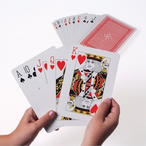 The Large playing cards are perfect for decorating at a tea party.  This is a complete deck including all 52 cards. The large playing cards have a traditional red backing and are made of a coated cardstock, like most standard playing cards.