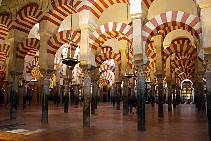 """The Forest of Columns in the Mosque of Córdoba, Spain. One of the most typical view from inside the Mosque. The highest number of columns in a single picture to try to recreate the feeling of the famous """"forest of columns."""" If you have not lot of people in the visit, it really looks like a forest. This picture corresponds to the section of Almanzor (Al-Mansur, who almost doubled the area of the mosque in the late X."""