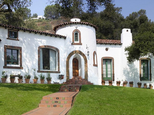 A White Body And Red Clay Tile Roof Is A Classic
