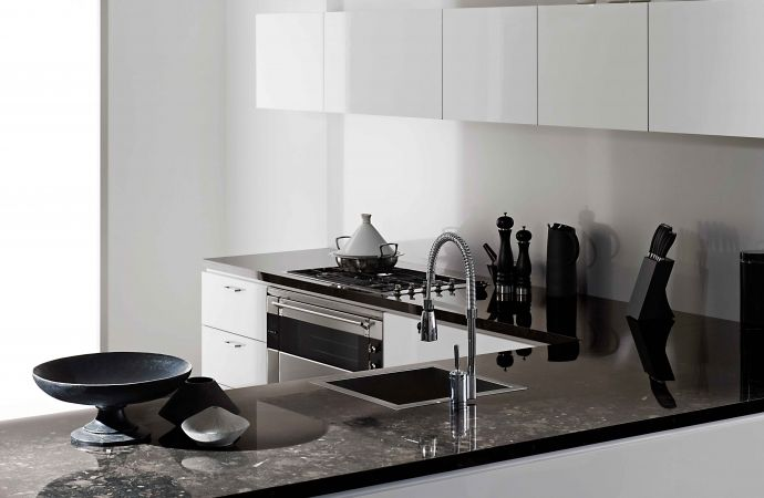 Cabinetry featuring Melteca Hi-Gloss Snowdrift. Bench top featuring Formica 180fx Black Fossilstone.