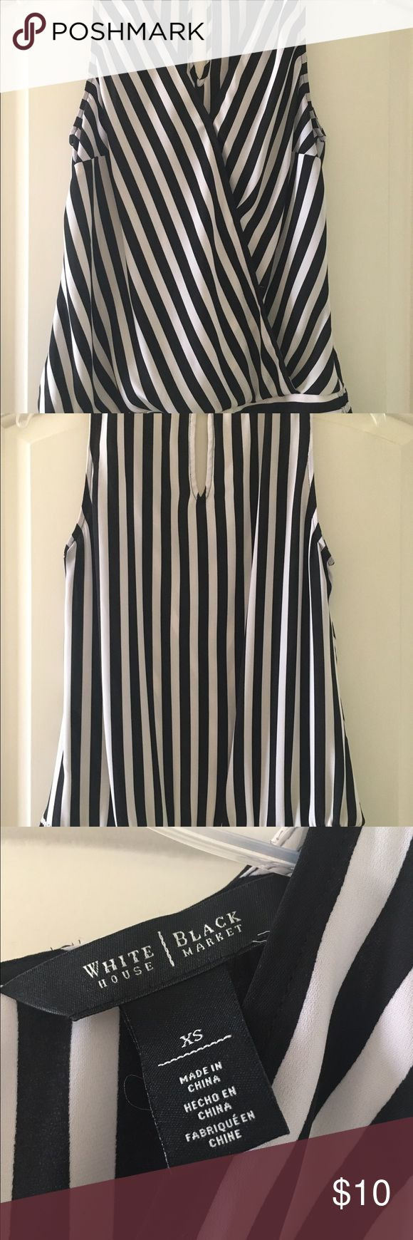 Black and White Striped Tank Top Black and white striped tank top from White House Black Market. Elastic waist on the bottom with two snaps in the front. White House Black Market Tops Tank Tops