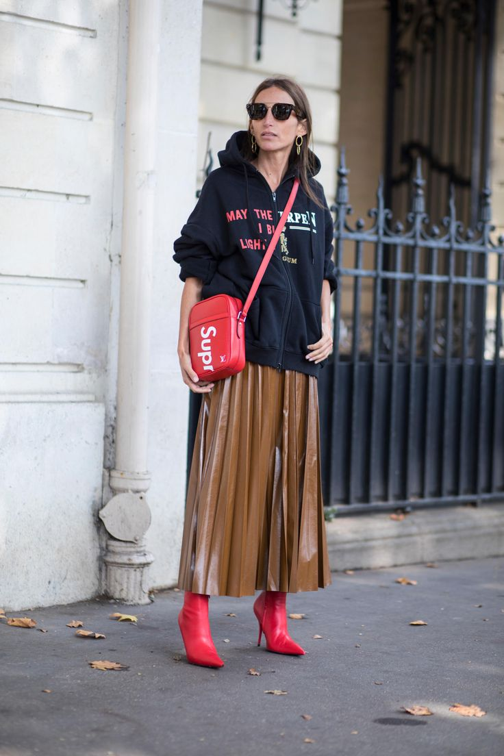 Knife pleats, red and words. On the street at Paris Fashion Week. Photo: Chiara Marina Grioni