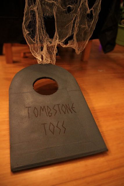 Tombstone Toss!  Halloween bags game...all you need is a cardboard box and gray spray paint.