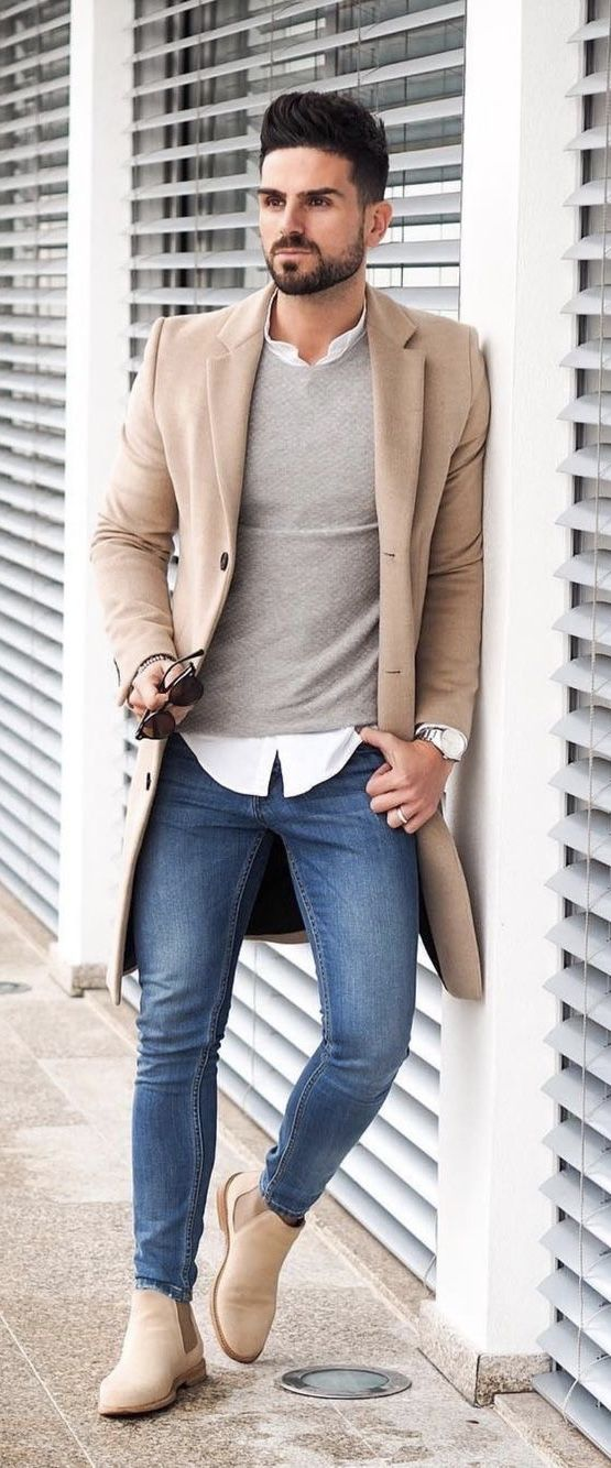 a4273db96f3 Fall business casual combo camel topcoat gray sweater white button up shirt  sunglasses silver watch slim cut blue jeans tan suede chelsea boots.