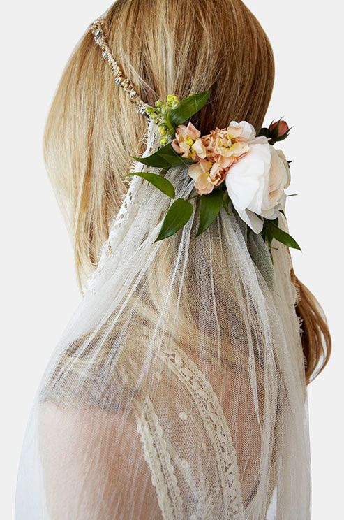 "Not crazy about these flowers, but love the understated ""headband"" of glimmer attached to a low, simple veil."