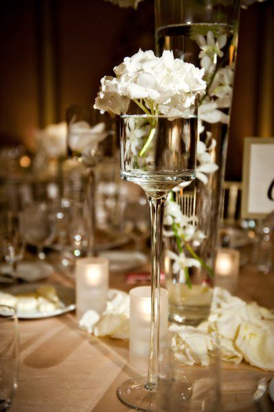 I like water integrated into centerpieces  (especially the tall vase in the back)