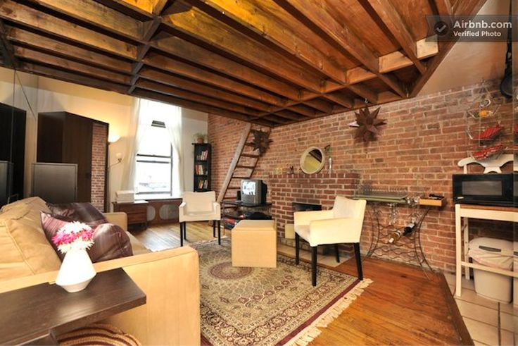 Get cozy in this brick-lined apartment.