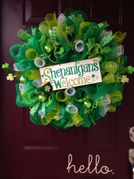 Welcome St. Patricks Day in style with this 26 Shenanigans Welcome deco mesh wreath. This wreath features three colors of mesh, shiny green
