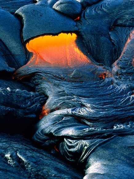 ~~Spreading Pahoehoe Lava ~ the hottest Hawaiian lava type, may darken into ropy strands or wrinkle into silver-sheened taffy, such as this flow in Hawai'i Volcanoes National Park.by Marc Moritsch~~