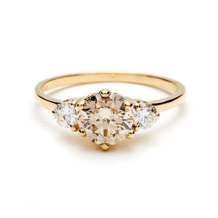 LOVE this three stone ring and how the 3 stones represent the past, present and future. So sweet!